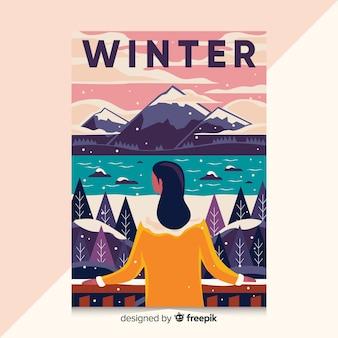 冬のイラストが描かれたポスターを手します。