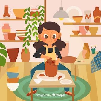 彼女の家で陶器を作る女性