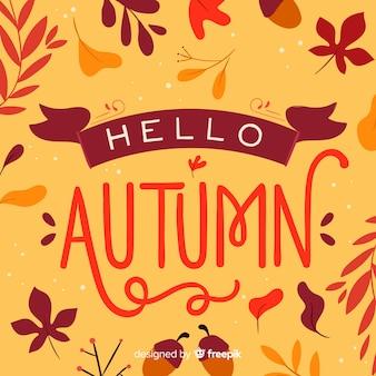 こんにちは秋のレタリングの背景の葉