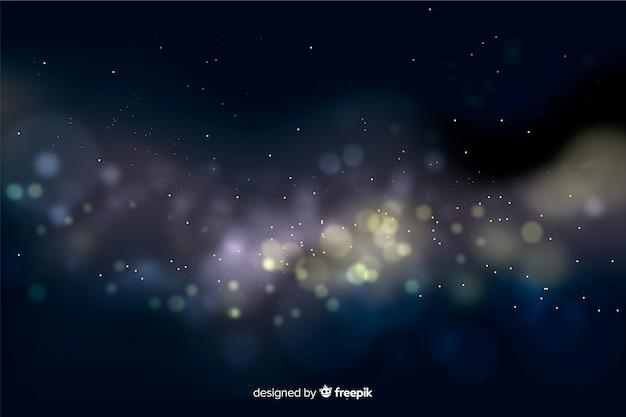 ボケ味の黄金の粒子の背景