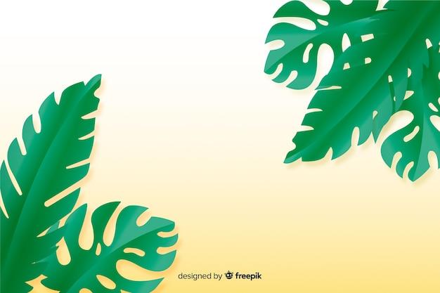 紙のスタイルで黄色の背景に緑の葉
