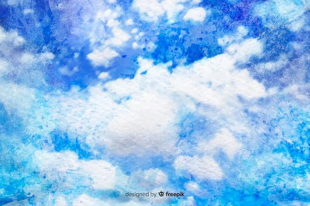 手描きの青い空を背景に雲