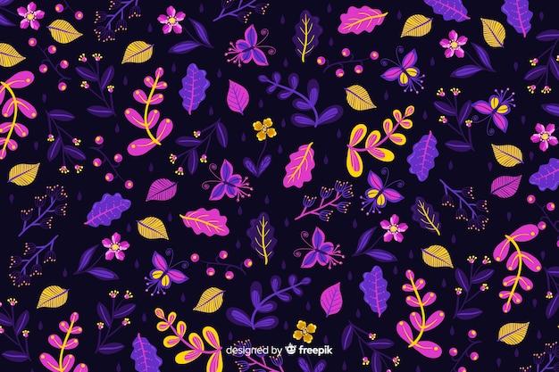 暗い背景に色とりどりの花