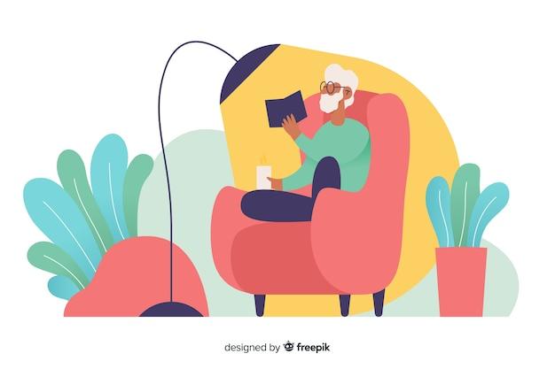 家でリラックスして本を読んでいる人