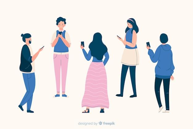 一緒にスマートフォンを見ている人々のグループ