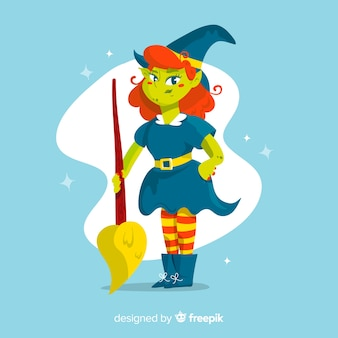 ハロウィーンパーティーのほうき衣装の魔女