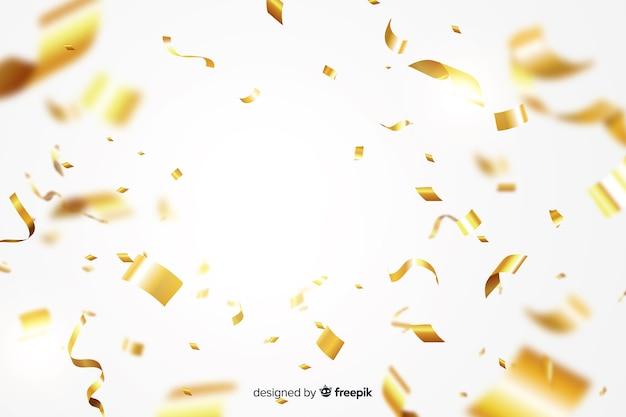 現実的な金色の紙吹雪の背景