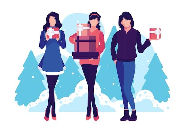 クリスマスプレゼントを買って、背景に木を持つ女性