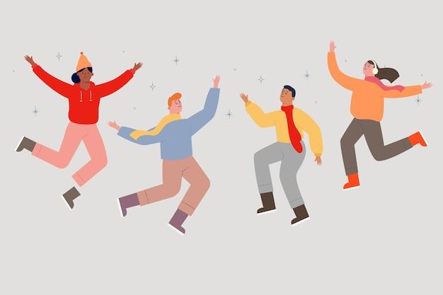 Группа людей в зимней одежде прыгает
