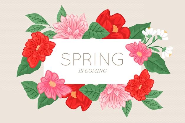 春のレタリングと異なるカラフルな花の背景