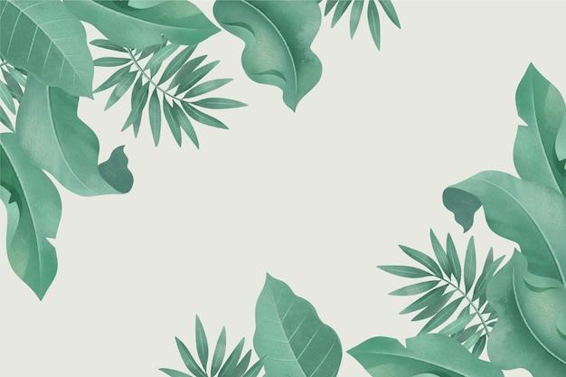 別の葉と空のスペースを持つ熱帯の背景