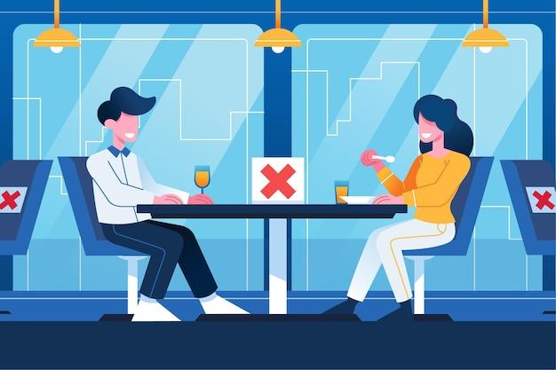 Социальная дистанцирующаяся пара в ресторане
