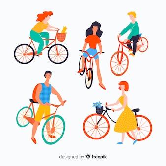 自転車に乗って手を引く人々