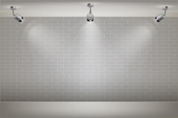 スポットライトの背景を持つ白いレンガの壁
