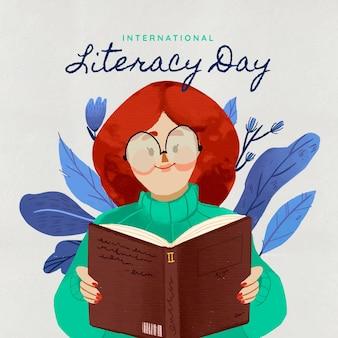 識字の日を読む若い女性