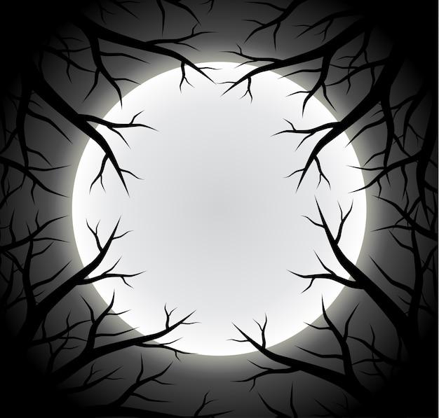 奇妙な満月の背景とシルエットの木の枝