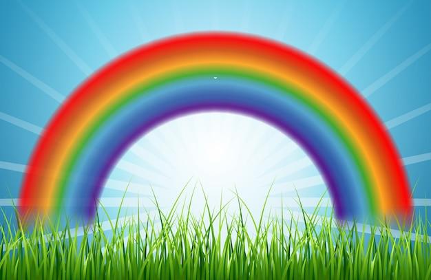 太陽と緑の草が浮かぶ明るい虹の青い空