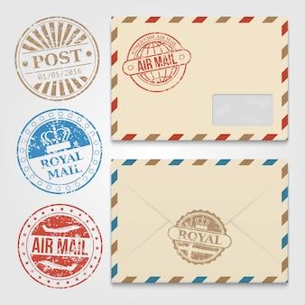 グランジ郵便切手とビンテージ封筒テンプレート