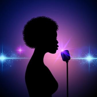 抽象的な背景に女性歌手のシルエット