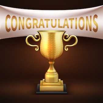 白い繊維バナーとお祝いの言葉を黄金の高級トロフィーカップ。ビクトリーカップシャイニーゴールデン