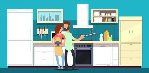 幸せなカップルが台所で料理を