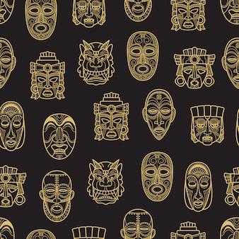 インドのアステカとアフリカの歴史的なトライバルマスクのシームレスパターン