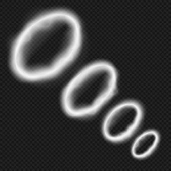 Белые кольца дыма от вейпа. курительная трубка или кальянная паровая тропа