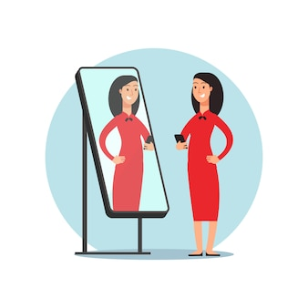 Сексуальная темноволосая женщина в красном платье делает селфи