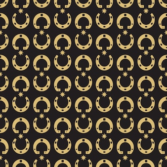 金の蹄鉄と星のシームレスパターン