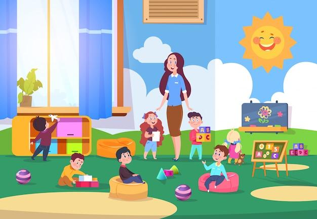 幼稚園のクラスで遊ぶ子供たち。かわいい子供たちは先生と教室で学習します。幼稚園の学校への準備