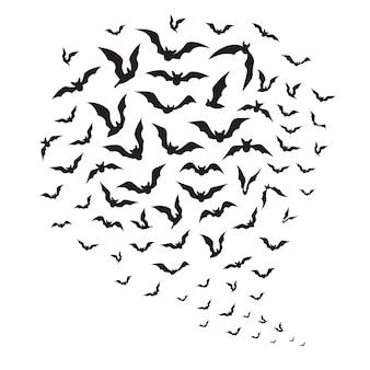 ハロウィーンの空飛ぶコウモリ。空にコウモリのシルエットの群れ。不気味なバットマンのハロウィーンの装飾