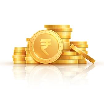 Золотые рупии монеты. индийские деньги, сложенные золотые монеты.