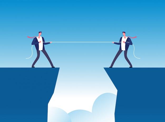Концепция конфликта. бизнесмены тянут веревку над пропастью.