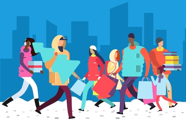 冬休みの人々。大都市通りに買い物袋、ギフト、クリスマスツリーを運ぶ人