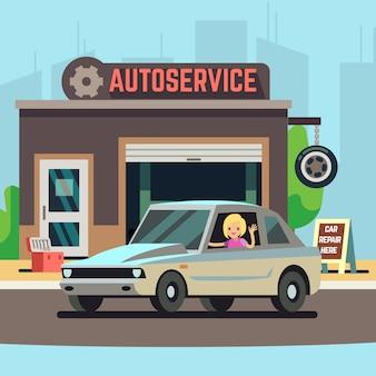 車のサービスステーションで幸せな女性ドライバー