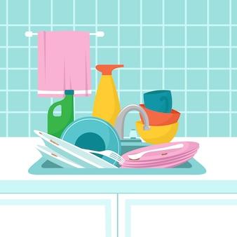 汚れた皿が付いている台所の流し。汚れた皿、グラス、洗浄スポンジの山。図