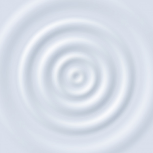 Молочная рябь. круговые волны йогуртового крема. закройте вид сверху белые молочные круговые пульсации текстуры