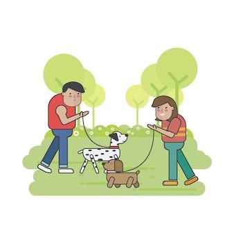 公園での犬の歩行者の会合