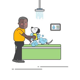 彼の犬を洗う男