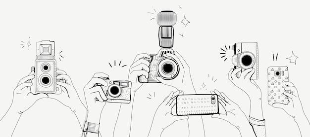 写真を撮っている手のベクトル