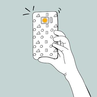スマートフォンで写真を撮っている手のベクトル