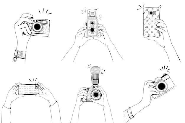 Рука с набором фотоаппаратов