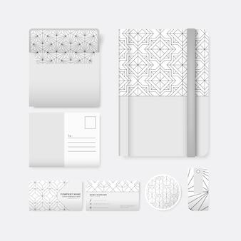 白い表面の文房具に黒い幾何学的パターンのセット