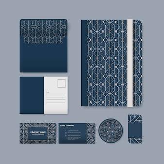 青い表面の文房具に白い幾何学的パターンのセット
