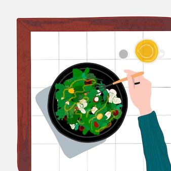 Человек, питающийся здоровым салатом