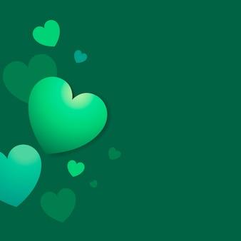 緑色の心の背景のベクトル