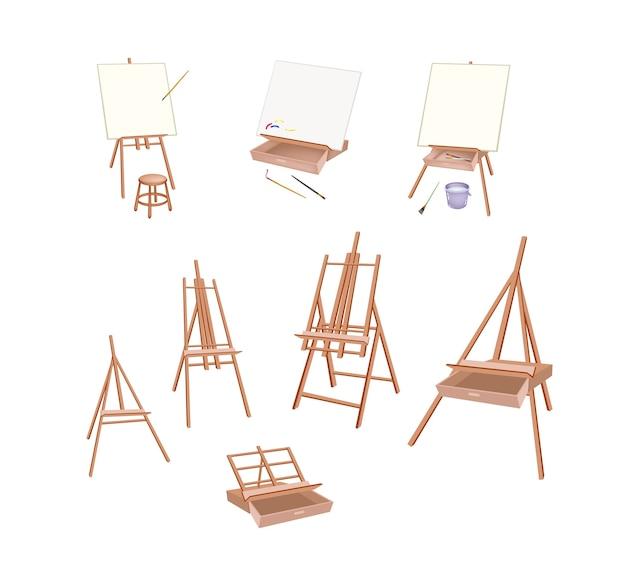 Набор деревянных мольберт на белом фоне