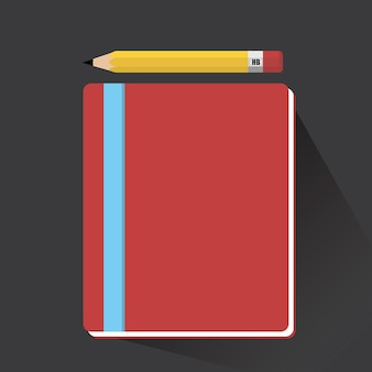 ノートと鉛筆の長い影