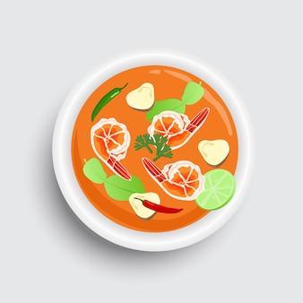 ボウルにタイ料理トムヤムクン。タイのスパイシースープトップビューデザイン。