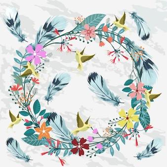 Красивый цветочный венок с пером и колибри.